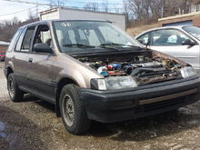 91 wagovan RT4WD, missing rear shaft, 213k miles all stock besides intake and suspension. BMW 13's running 175/70/13's.