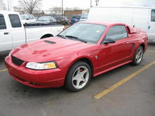 My stang in the lot of the dealership right before I bought it