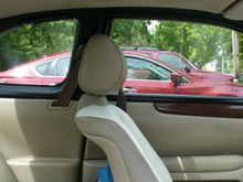 Painted the door window trims with DupliColor Vinyl/Fabric Gloss Black to match the A-pillar and quarter window trims.