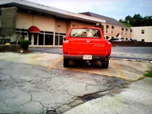 My 1995 Red Ford F150 Flareside extended cab pickup truck.