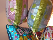 Mom got us a pink and blue balloon. After the reveal my sister let the pink one go outside haha.