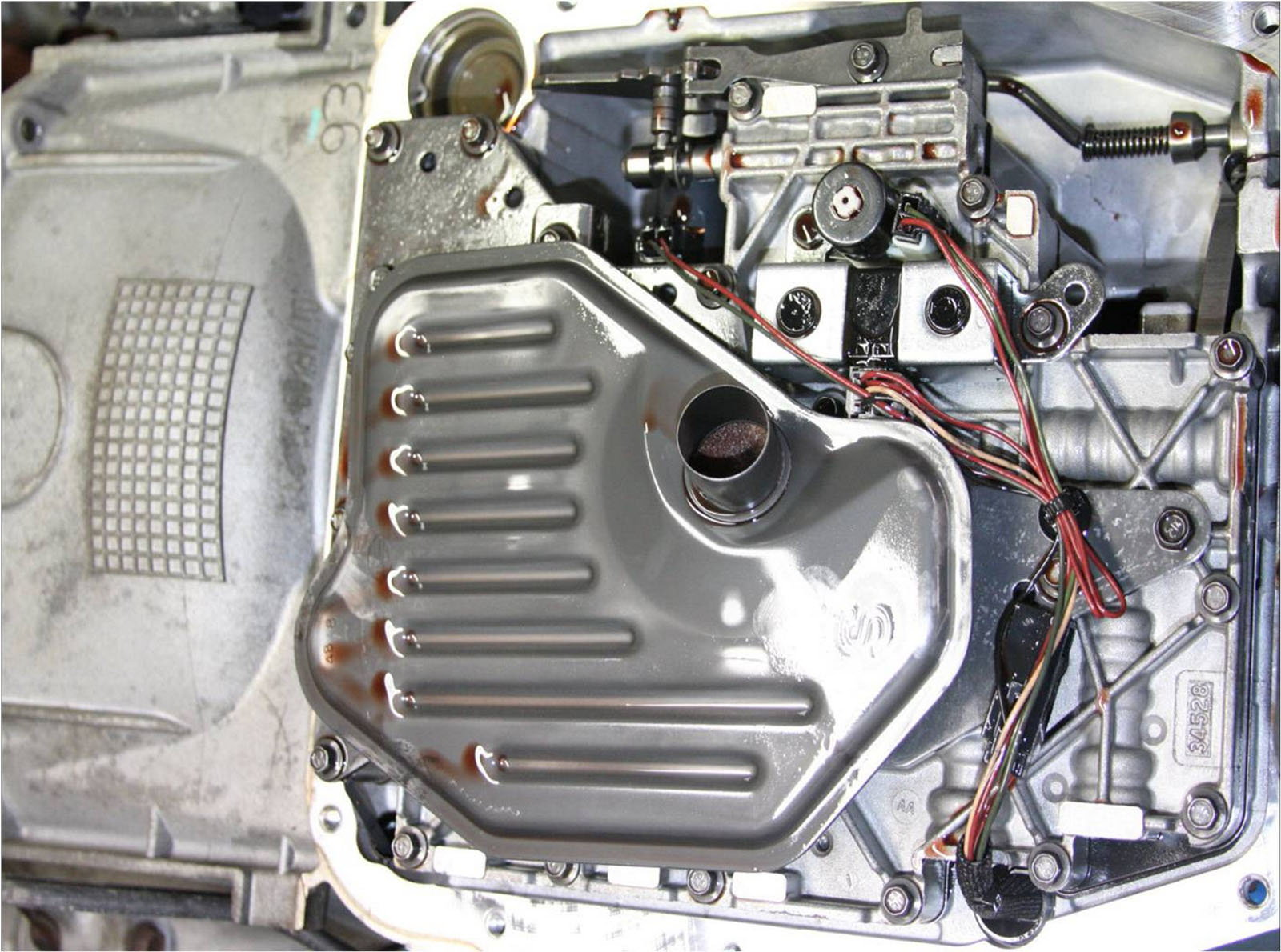 The gray dish is the transmission filter you do not need to replace this but you should clean it