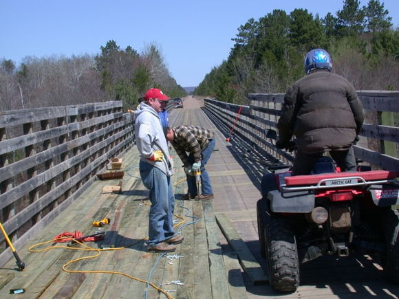While shorthanded volunteers worked on the Wild Rivers Trail near Trego WI (Spring 2004), there was no shortage of riders enjoying the trail but feeling no obligation to help.