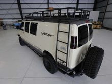 12' rcustom roof rack with dual ladders. Rear bumper with tire carrier by WeldTec Designs