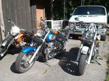 My 1990 Dodge Ran Van B250, Triumph Bonneville America 2012 and wife`s 2005 Bonneville America plus my sons 50cc Aprilia