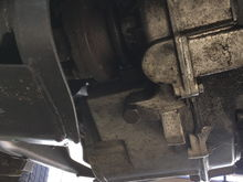 Transfer case laying on the crossmember