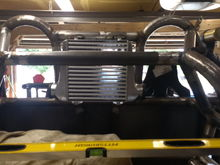 The tube going from one shock hoop to the others is removable with 4 bolts. More support for the shocks.
