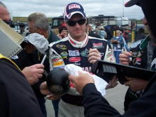 Dale Jr Signing the Dash out of the car.
