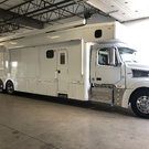 2011 Showhauler 600HP Volvo, White, 4 slides, 2 baths, bunk