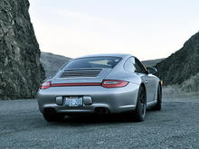 The red rear reflector is certainly a tribute to the classic 911s.