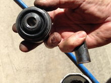 OEM 2 hole hinge bushing on the left after just 40,000 klms, the Moog K200792 bearing bushing in the right