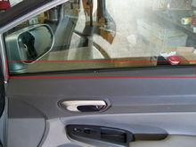 rubber/felt against the inside of passenger window.