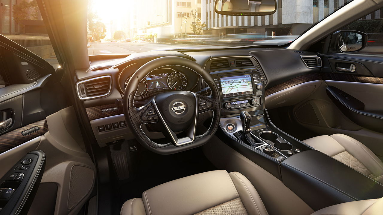nissan maxima or take lexus es if you want more elegant luxurious car quiet cabin and smooth ride as well just my 2 cents as read in many reviews