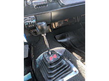 4-speed manual with Hurst shifter