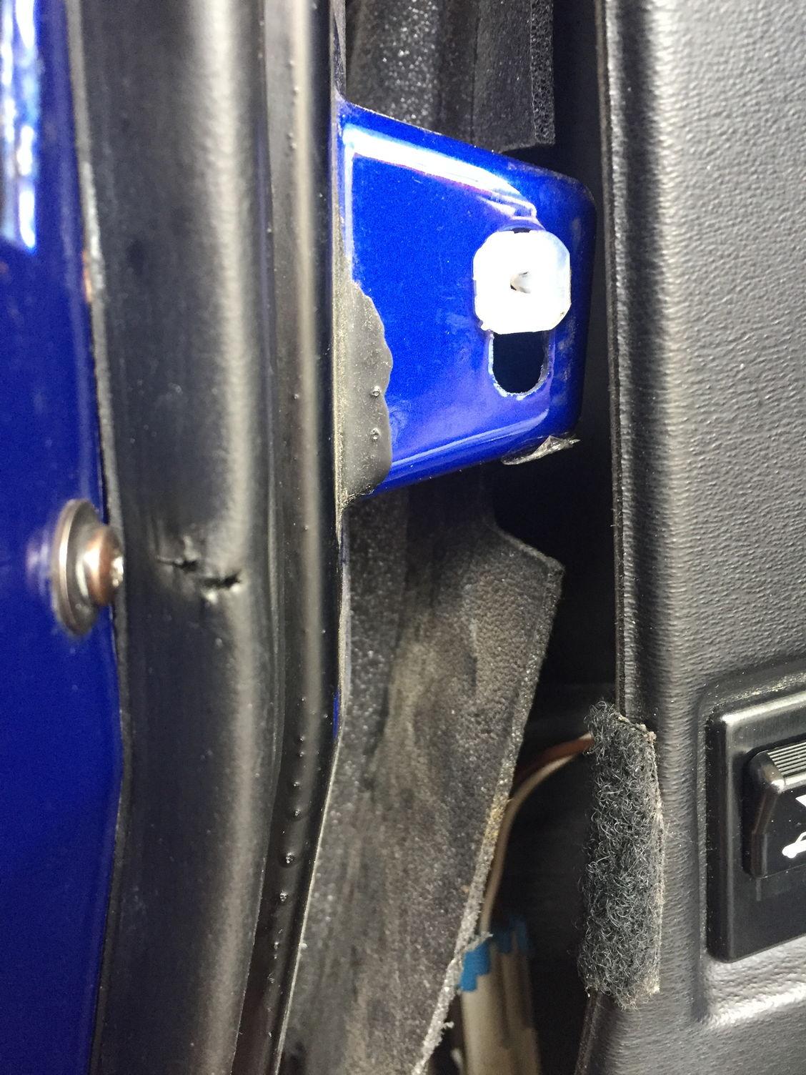 Effective, permanent fix to sagging door trim panels, using wire ...