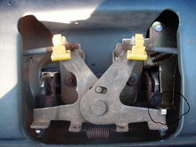 Here's the tailgate lever in the lock position. Don't be fooled. This may look like just a piece of metal only holding one side of the OEM lever preventing it from flexing open when pulled on the outside. Also, with its flimsy look, in all reality if you pulled the handle on the outside very hard it would snap right? Wrong! Remember that the little bit of chrome you see at the bottom of the picture is the outside handle and it is in fact not a part of the oem (x) looking lever you see that's on the inside. So, when the lock is engaged and there is to much pressure on the chrome handle it will slip out of position leaving the (x) shaped oem lever in the same place unmoved thus staying locked. I hope you got that. Just think that part A moves part B but if part B is locked then part A is subject to slip or bypass. Part A being the chrome handle and part B being the (x) shaped lever.