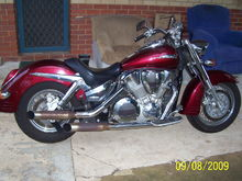 Honda VTX 1300. 1300cc V-Twin. Open pipes, slash cut cans, rear seat removed. The fine weather toy.
