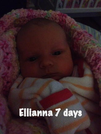 Ellianna at 1 week old, wide awake being curious.. :)