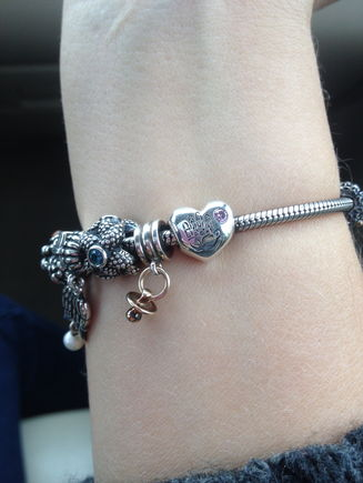 My dh bought me a new charm for my pandora.  The one on the end.  It says, its a girl on the back.